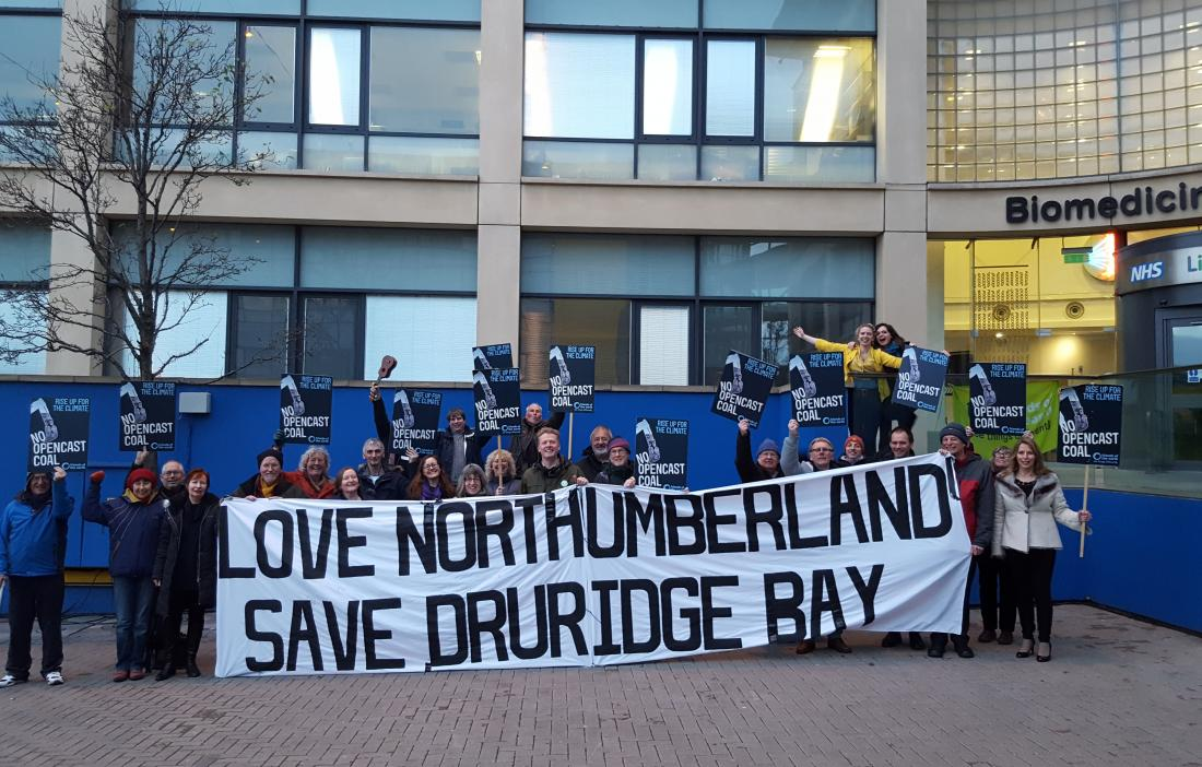 """Local activists holding a banner that reads """"Love Northumberland, Save Druridge Bay"""""""
