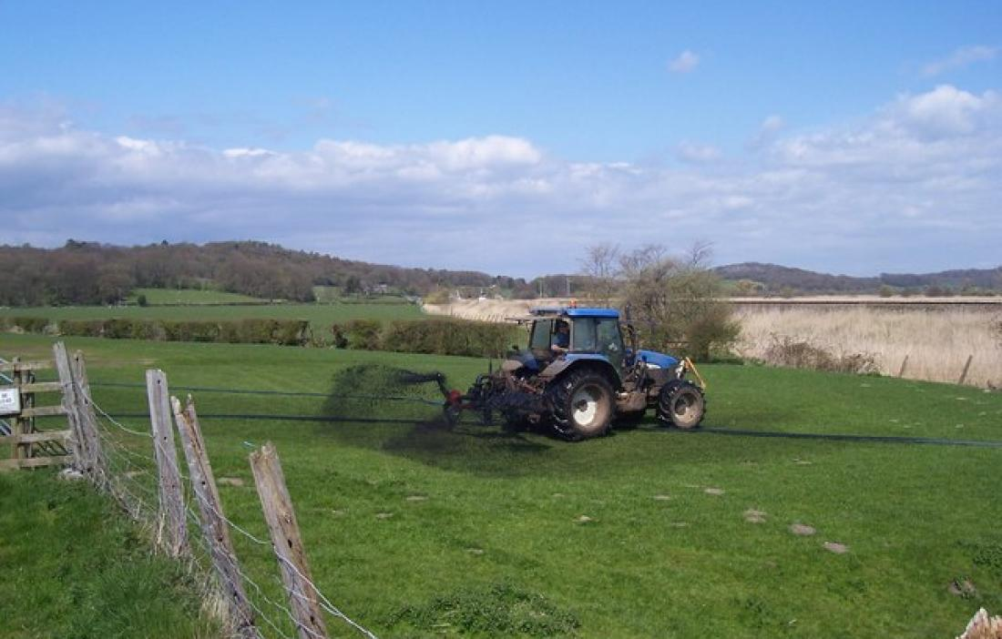 Slurry tanker spraying field