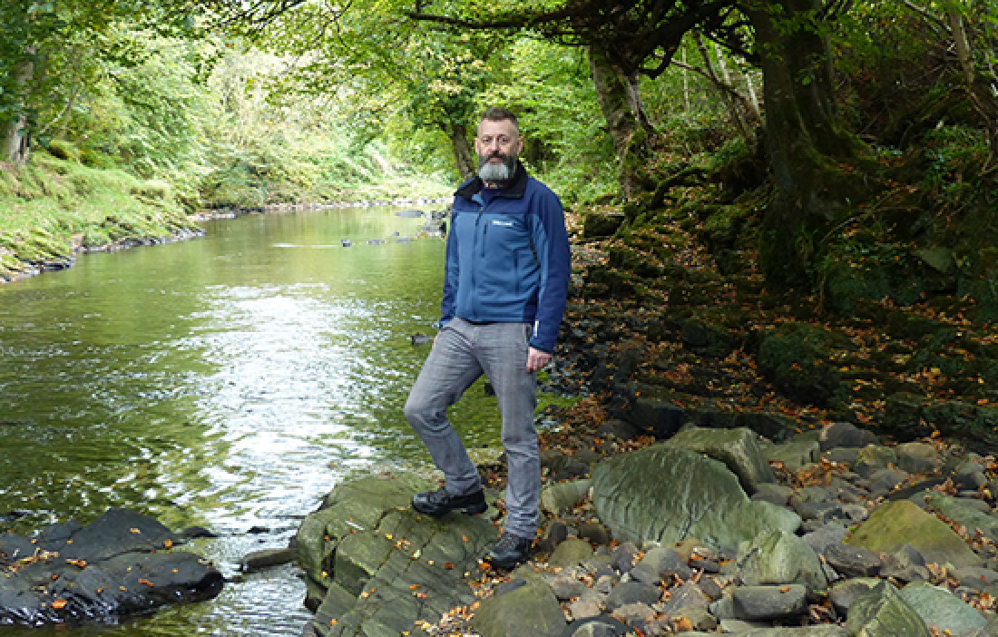 Dean Blackwood in front of a river